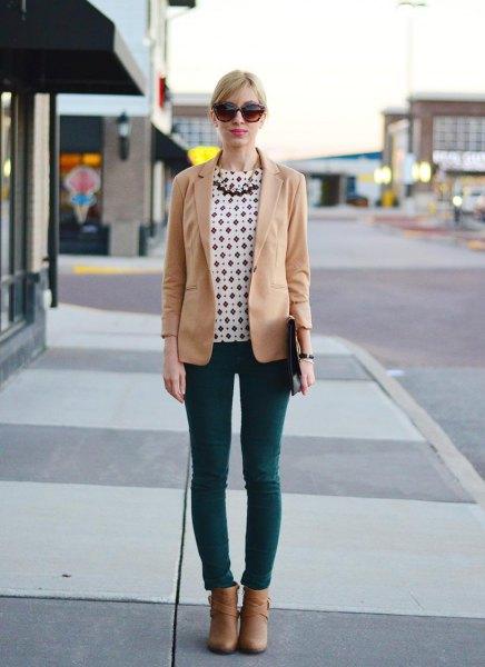 white and black dot blouse dark gray skinny jeans