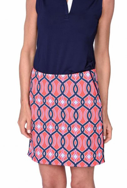 navy blue v-neck sleeveless top with blue and pink skirts