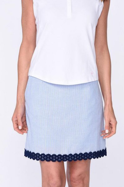 white sleeveless top with blue peeled hem