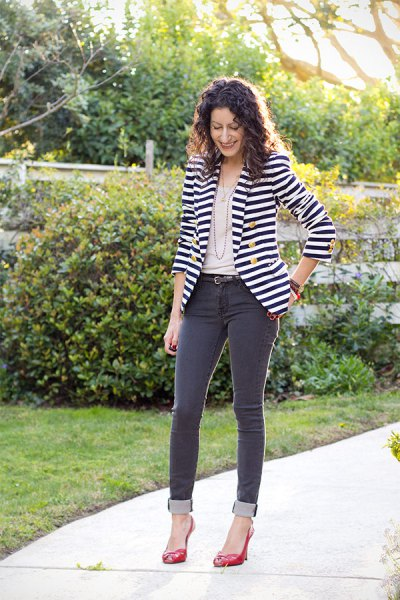 black and white horizontal striped double breasted blazer with gray jeans