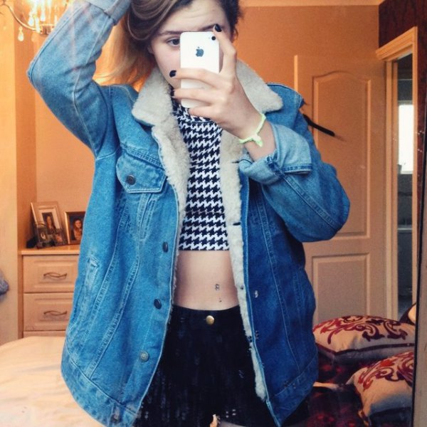 black and white patterned crop top with blue fur lined denim jacket