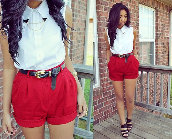 white sleeveless button up shirt with red high waist shorts