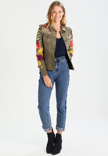 green embroidered denim jacket with high-cuffed jeans
