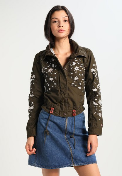 green floral embroidered jacket with blue denim mini skirt