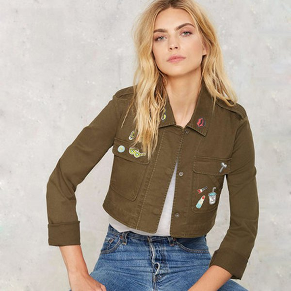 green short card jacket with white chiffon top and blue jeans