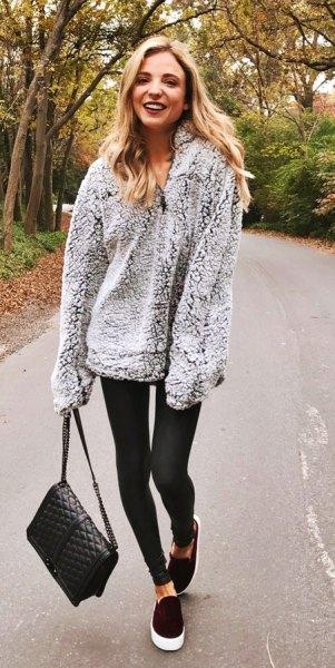 gray oversized fleece shirt with black leggings