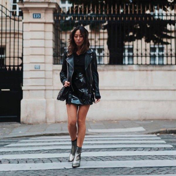 black shirt and mini leather skirt