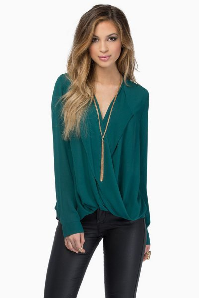 teal wrap shirt with black leather pants