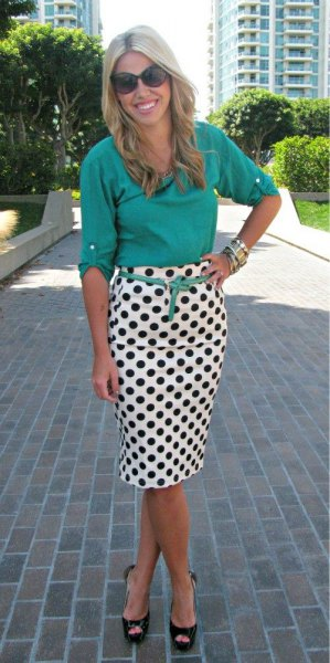 light teal shirtless shirt with black and white waist skirt