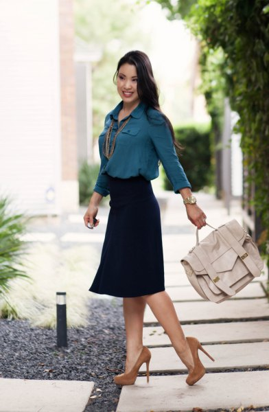 dark teal button up chiffon shirt with black midi skirt