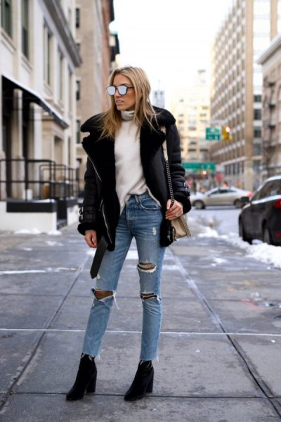 black leather jacket with white sweater