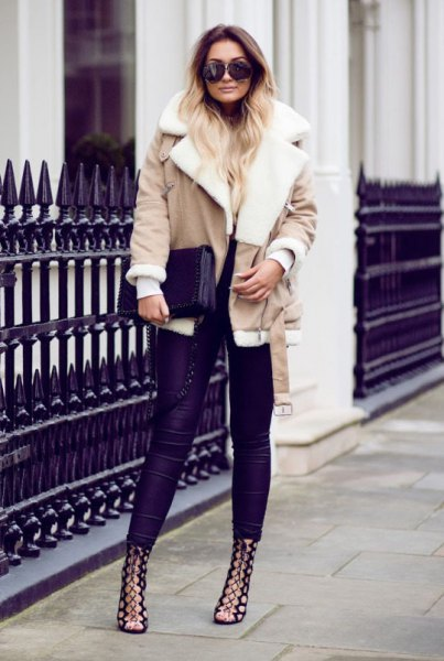 pink shearling jacket with dark blue skinny jeans