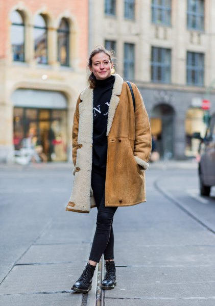 brown long shearling skirt with black sweater and cropped jeans