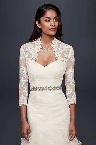 best white sweetheart neckline wedding dress with lace shawl