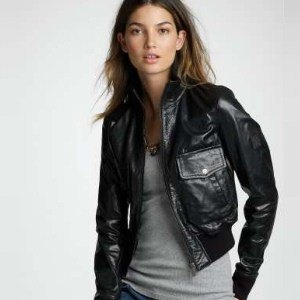 black leather jacket with gray western blue jeans