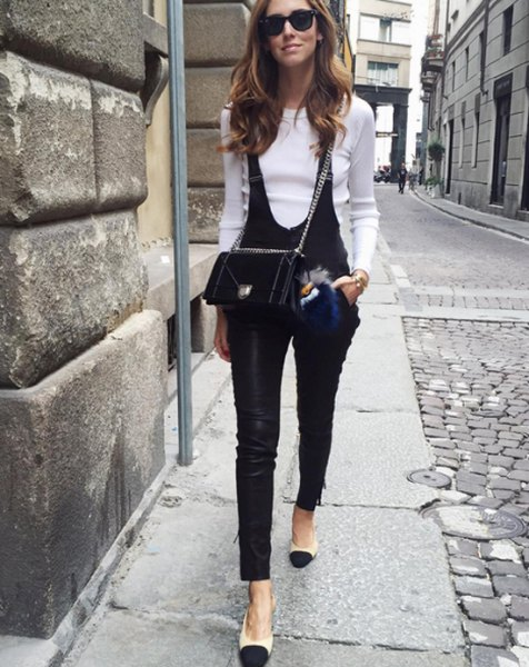white sweater with suede with black leather overalls