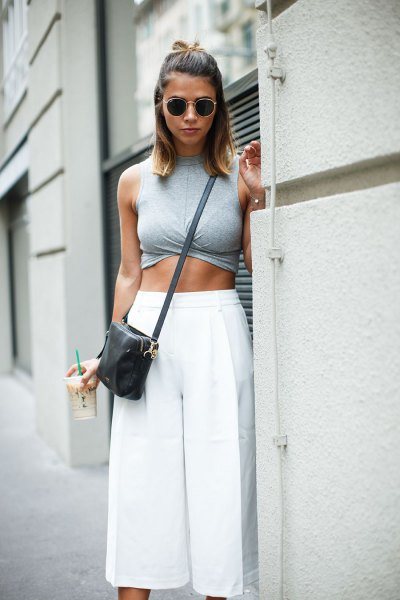 gray sleeveless crop top with white culottes