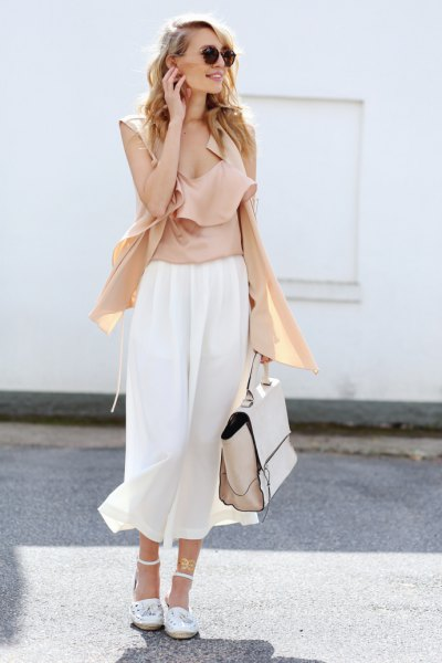 pink sleeves without sleeveless blouse with white culottes