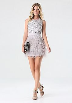 white belt mini feather dress with silver sequin details