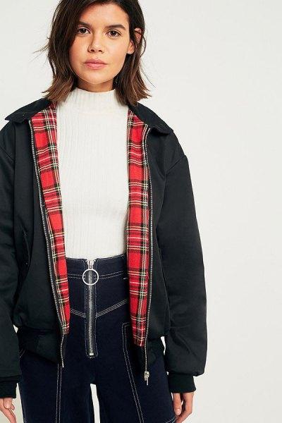 dark gray harrington jacket with white knitted sweater