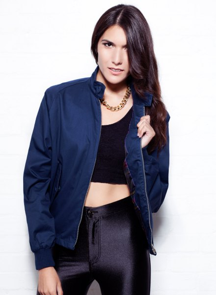 navy jacket with black crop top and silk hair pants