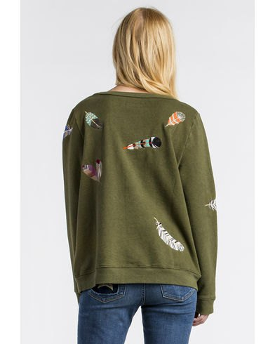 green cartoon embroidered sweater with matching slim jeans