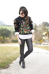 black embroidered sweater with white leather leather buttons