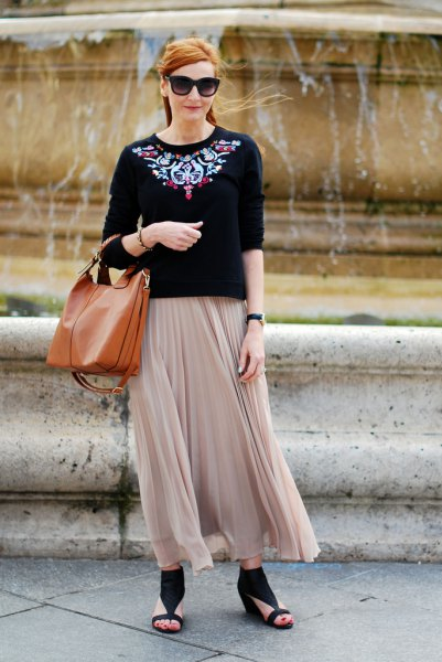 black and silver sweater with light pink pleated maxi skirt