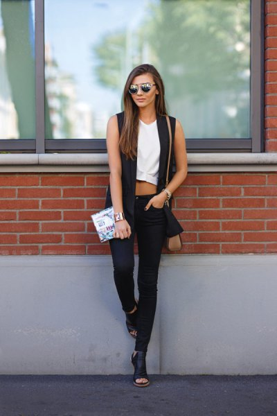 white cropped sleeveless top and black skinny jeans