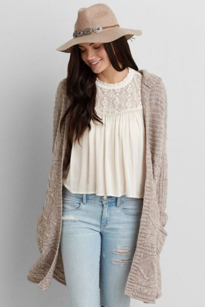 straw floopy hat with white lace blouse gray long hood cardigan