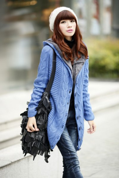 blue hooded cardigan with white knitted hat