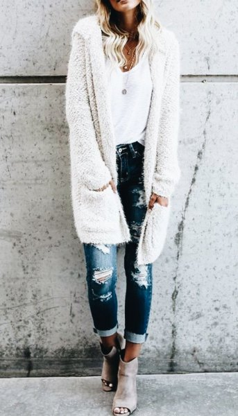 white fuzzy long hooded cardigan with ripped skinny jeans