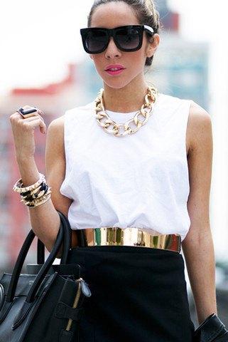 gold belt white sleeveless top black mini skirt