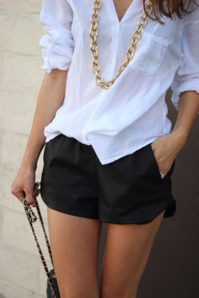 white linen shirt with black floating shorts gold necklace