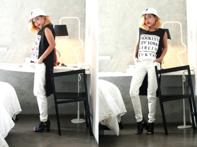 white bucket hat with black sleeveless high low jeans