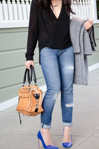black deep v-neck wrap blouse with cuffed skinny jeans