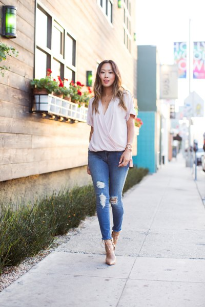 pale pink chiffon wrap blouse with ripped skinny jeans