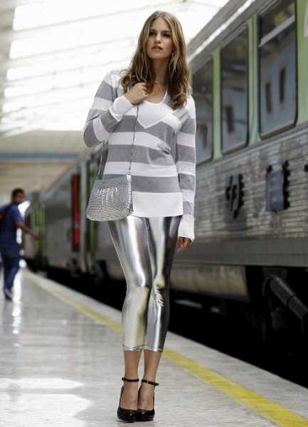 gray and white wide striped sweater with metallic leggings
