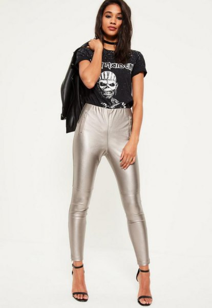 black print tee with leather jacket and silver leggings
