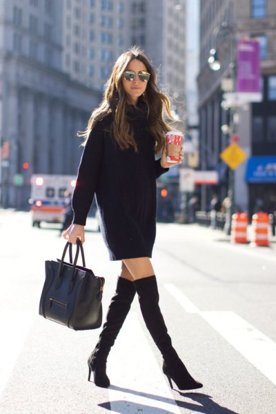 black long-sleeved mini dress with high thigh boots