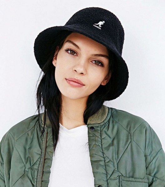 black bucket hat with white tee and green bomber jacket
