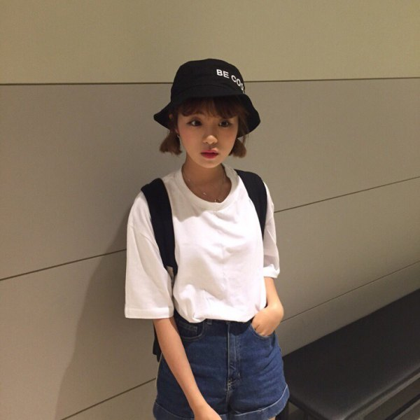 black bucket hat with white big tee and flowing shorts with denim