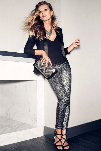 black deep v-shirt with silver glitter pants