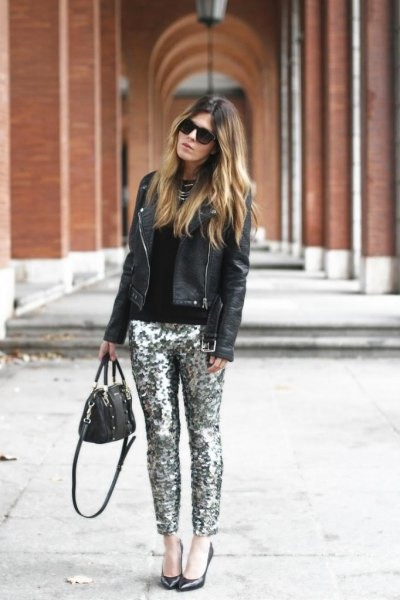 black leather jacket with fitted sweater and silver pants