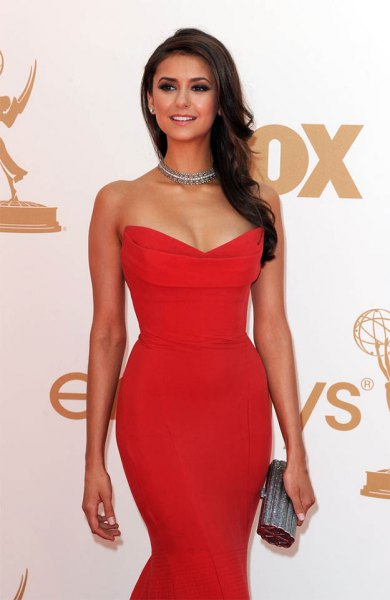 red strapless mid-waist dress with gold choker necklace