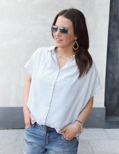 gray and white striped short sleeve shirt with jeans and gold choker necklace