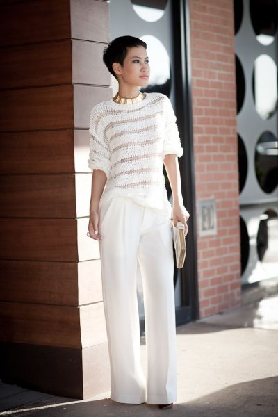 white and gray striped sweater and wide leg trousers