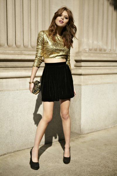 gold glitter crop top with black flowing shorts