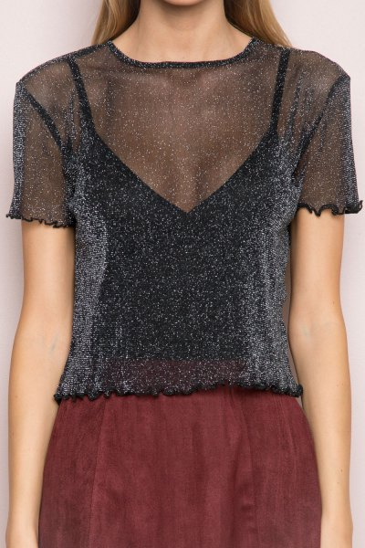 black glitter semi sheer top with green suede mini skirt