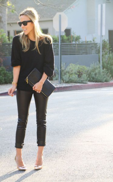 black knit sweater with leather pants white high heeled loafers